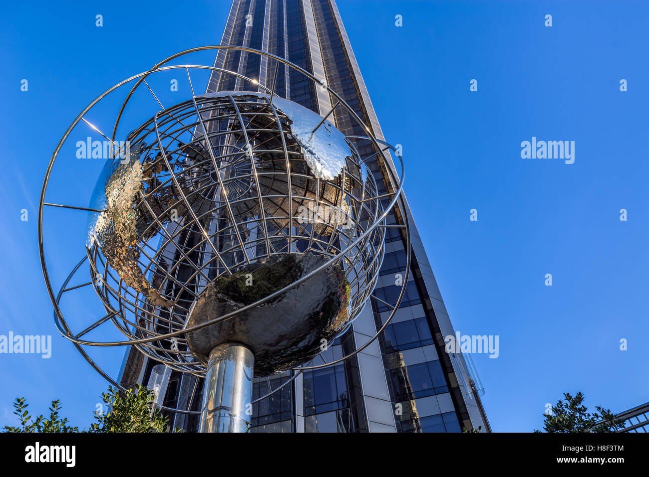 Trump International Hotel and Tower skyscraper with metal globe sculpture. Midtown, Manhattan, New York City - Stock Image