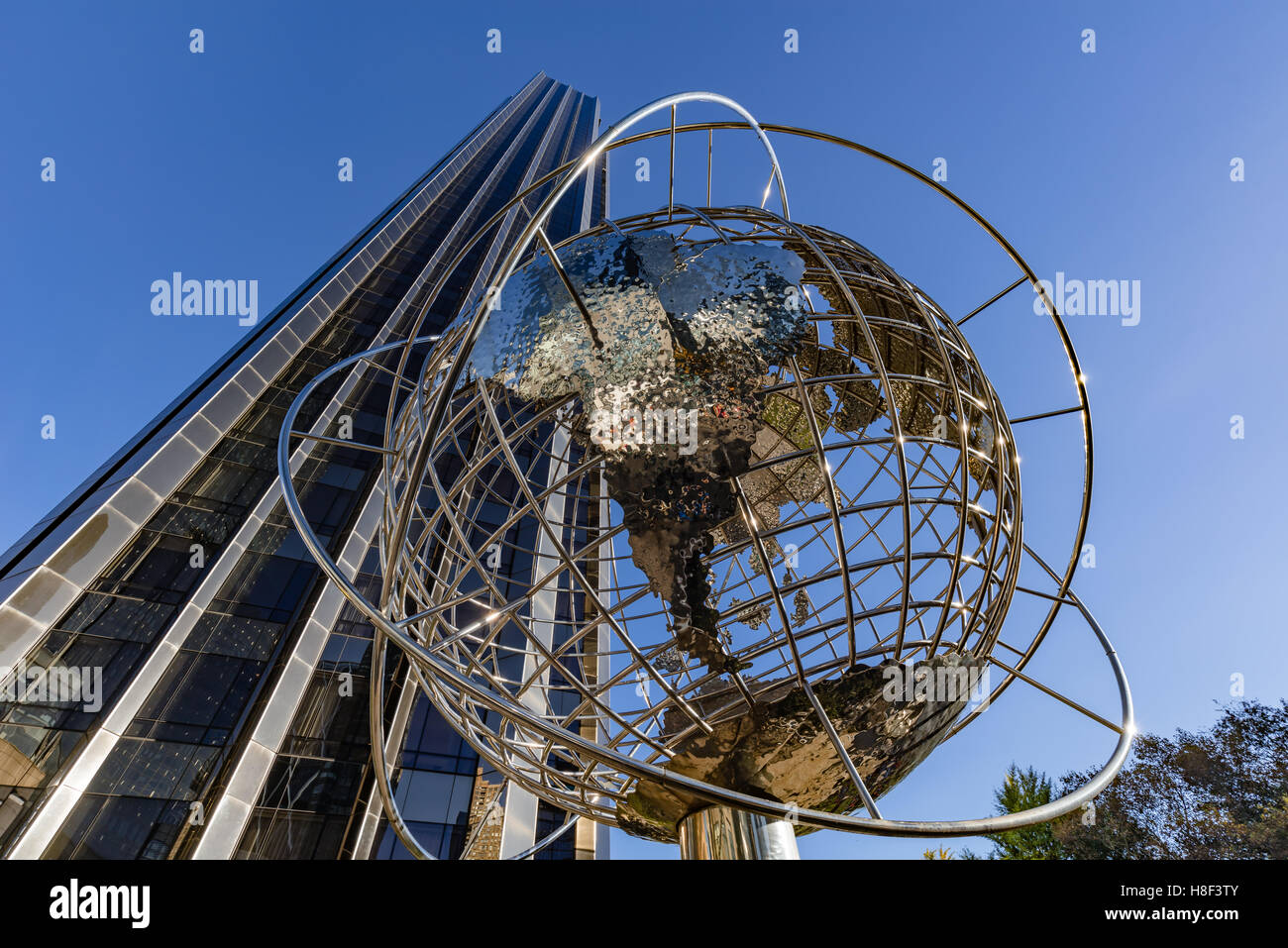 Trump International Hotel and Tower skyscraper with metal globe sculpture. Midtown, Manhattan, New York City Stock Photo