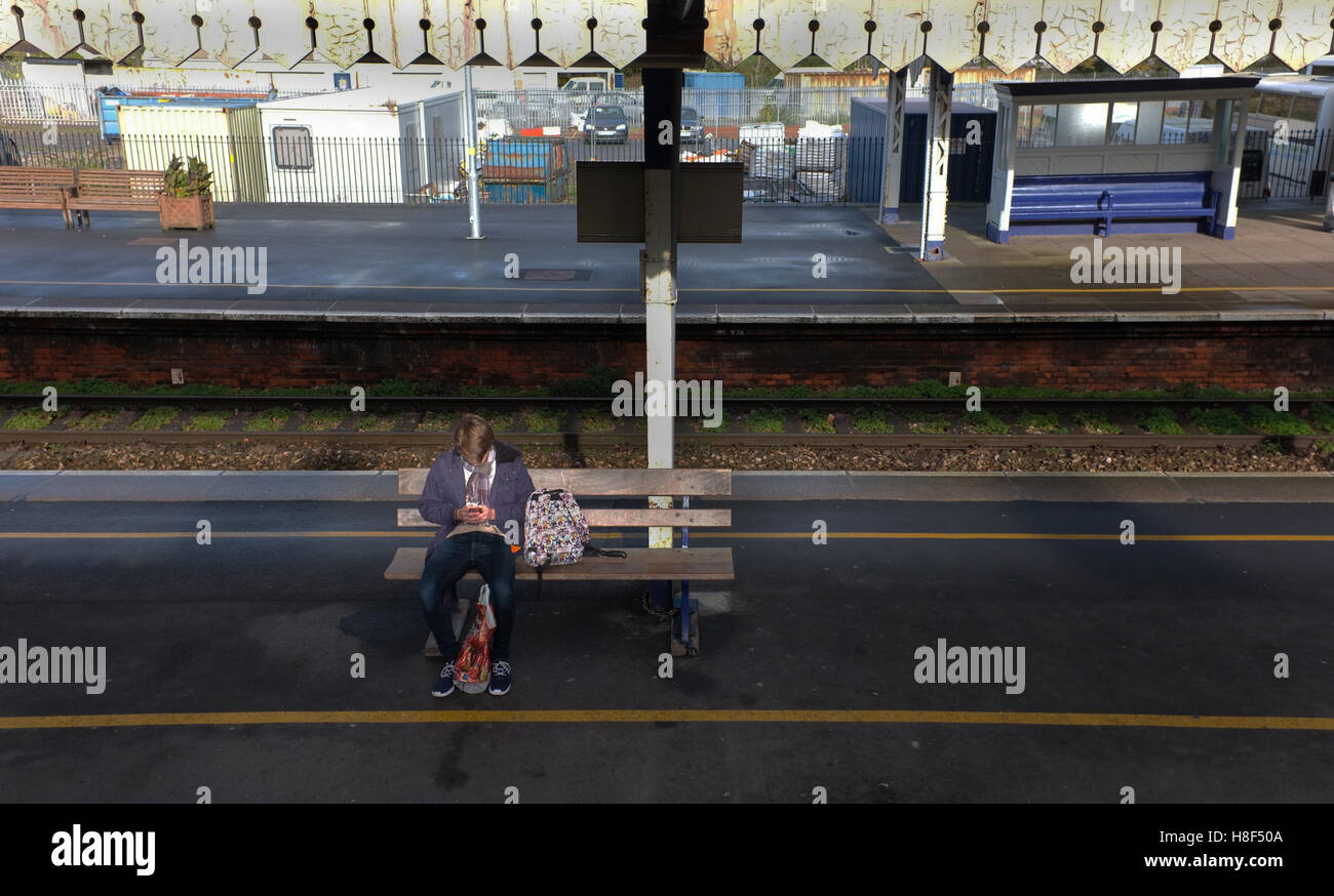 Student on train platform at Truro, Cornwall - Stock Image