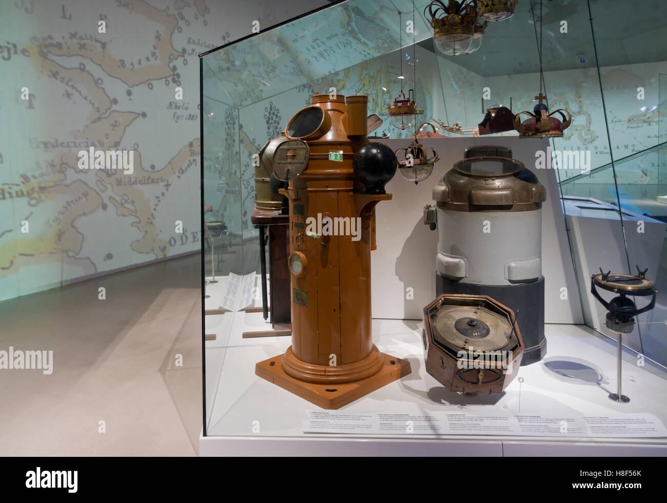 Old binnacles, compasses and nautical equipment at the Danish Maritime Museum (M/S Museet for Søfart) in Elsinore - Stock Image