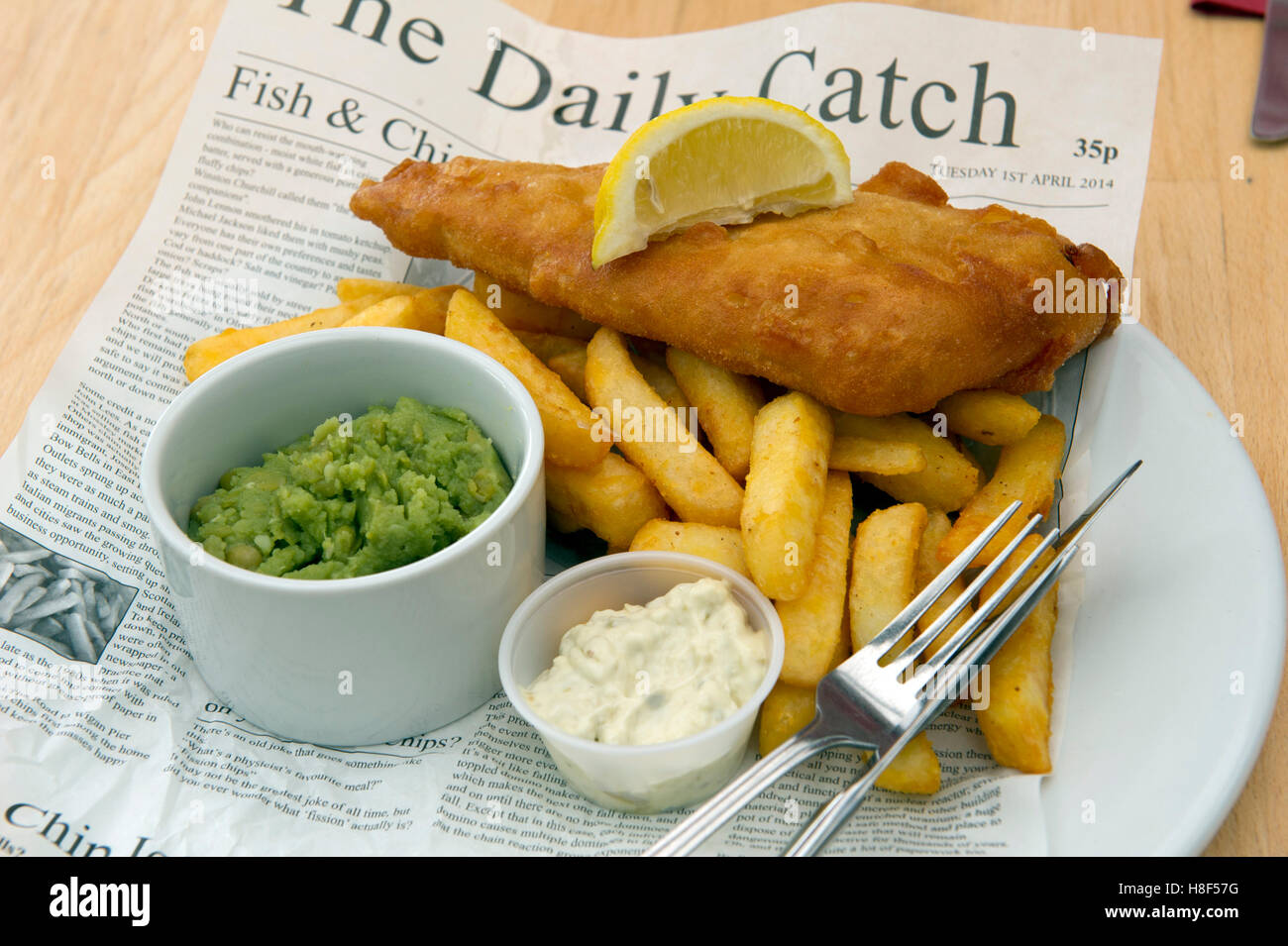 Traditional British fish & chips, served in a newspaper. a UK Stock Photo: 125723236 - Alamy