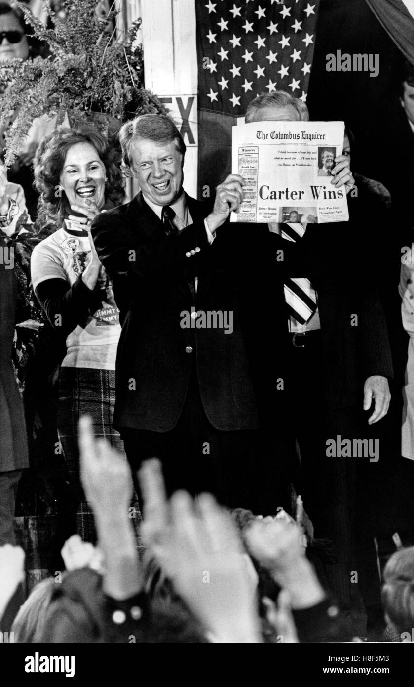 President elect Jimmy Carter holds a newspaper with the headline 'Carter Wins!' as he celebrates with crowds - Stock Image