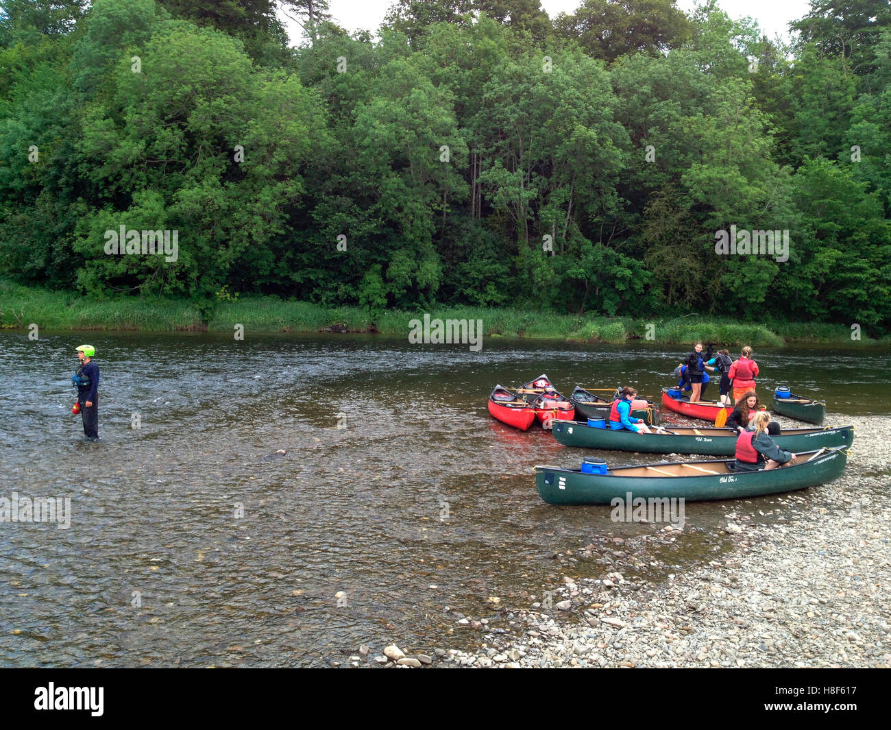 Teenagers in organized group canoeing on River Wye at The Warren Hay-on-Wye Powys Wales UK - Stock Image
