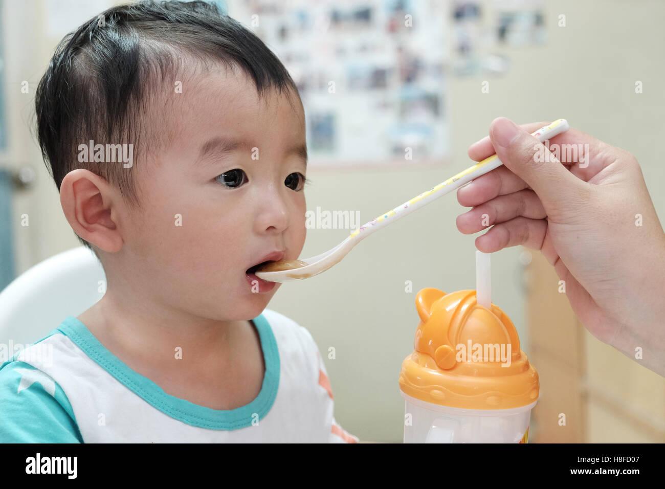 Feeding oriental teen