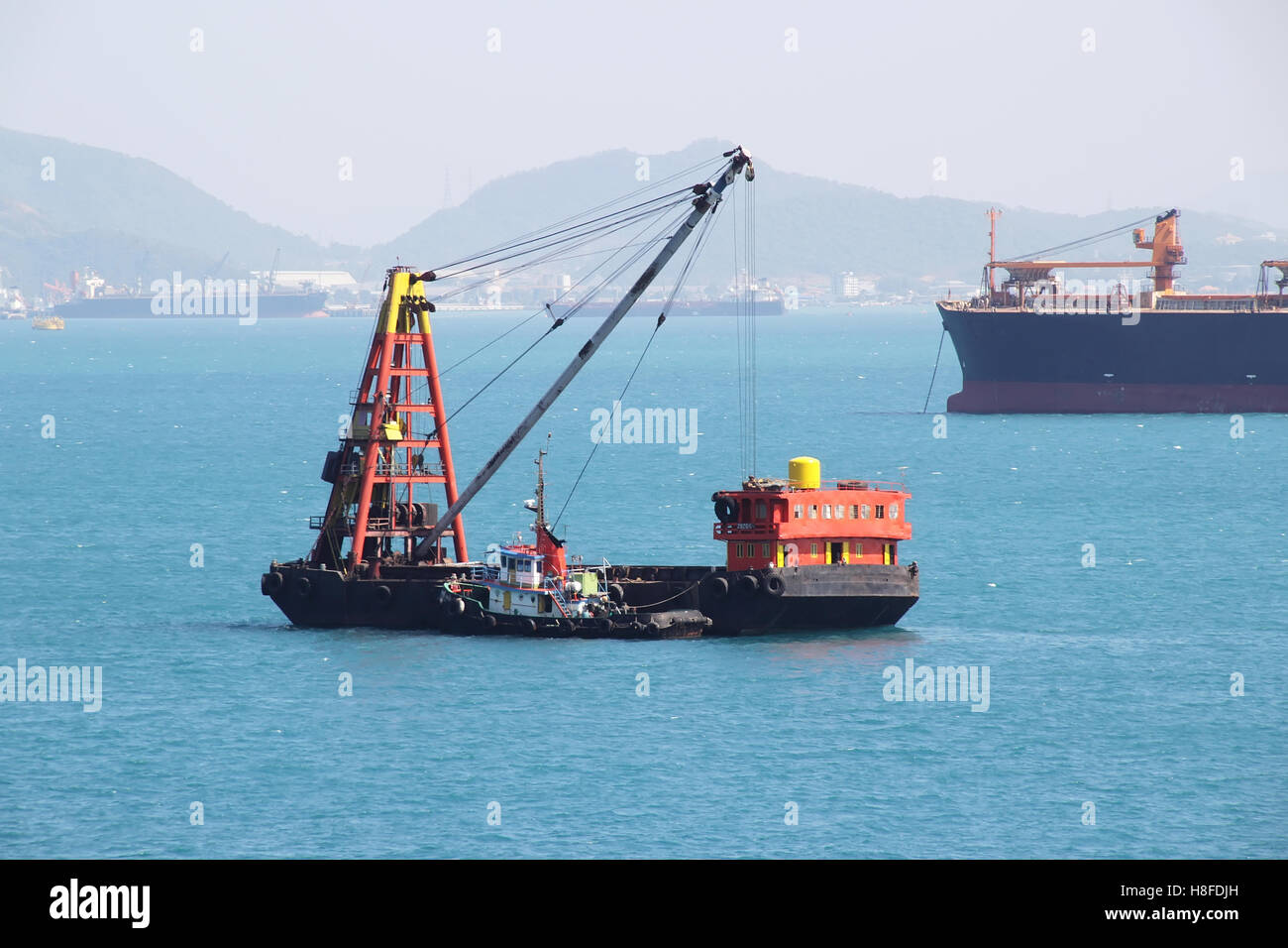 Barge Ship, Cargo Ship, Ocean Vessel in the Sea at Ko Sichang Chonburi, Thailand - Stock Image