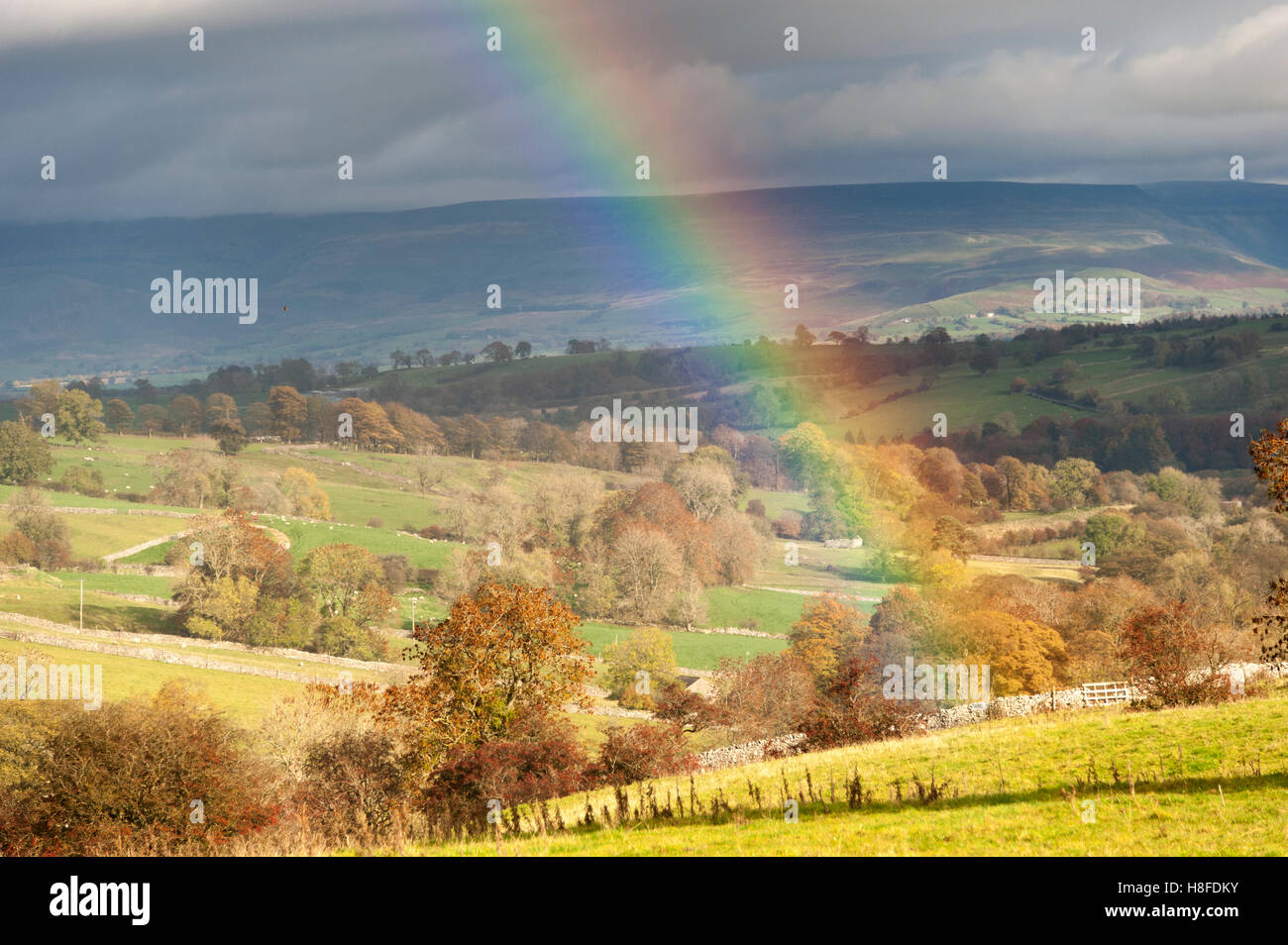 Rainbow over farmland, overlooking the Eden Valley, Cumbria, UK. - Stock Image