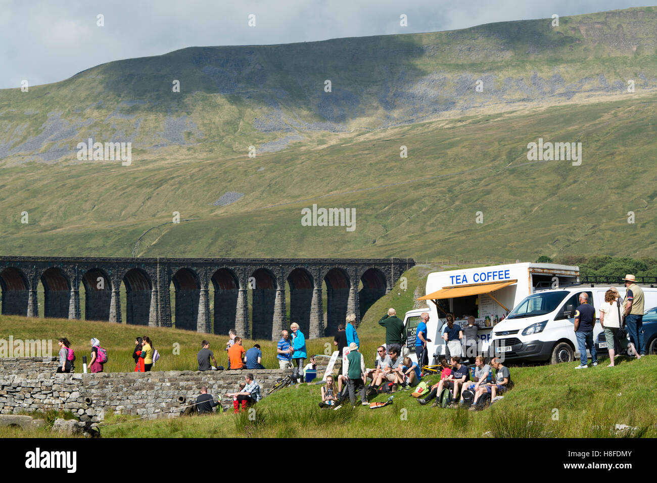 Ribblehead Viaduct on the Settle to Carlisle Railway, with lots of tourists around. Yorkshire Dales National Park, - Stock Image