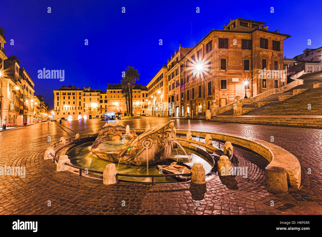 Spanish steps square and boat shaped fountain in Rome, Italy, at sunrise.Historic architecture of old palaces and - Stock Image