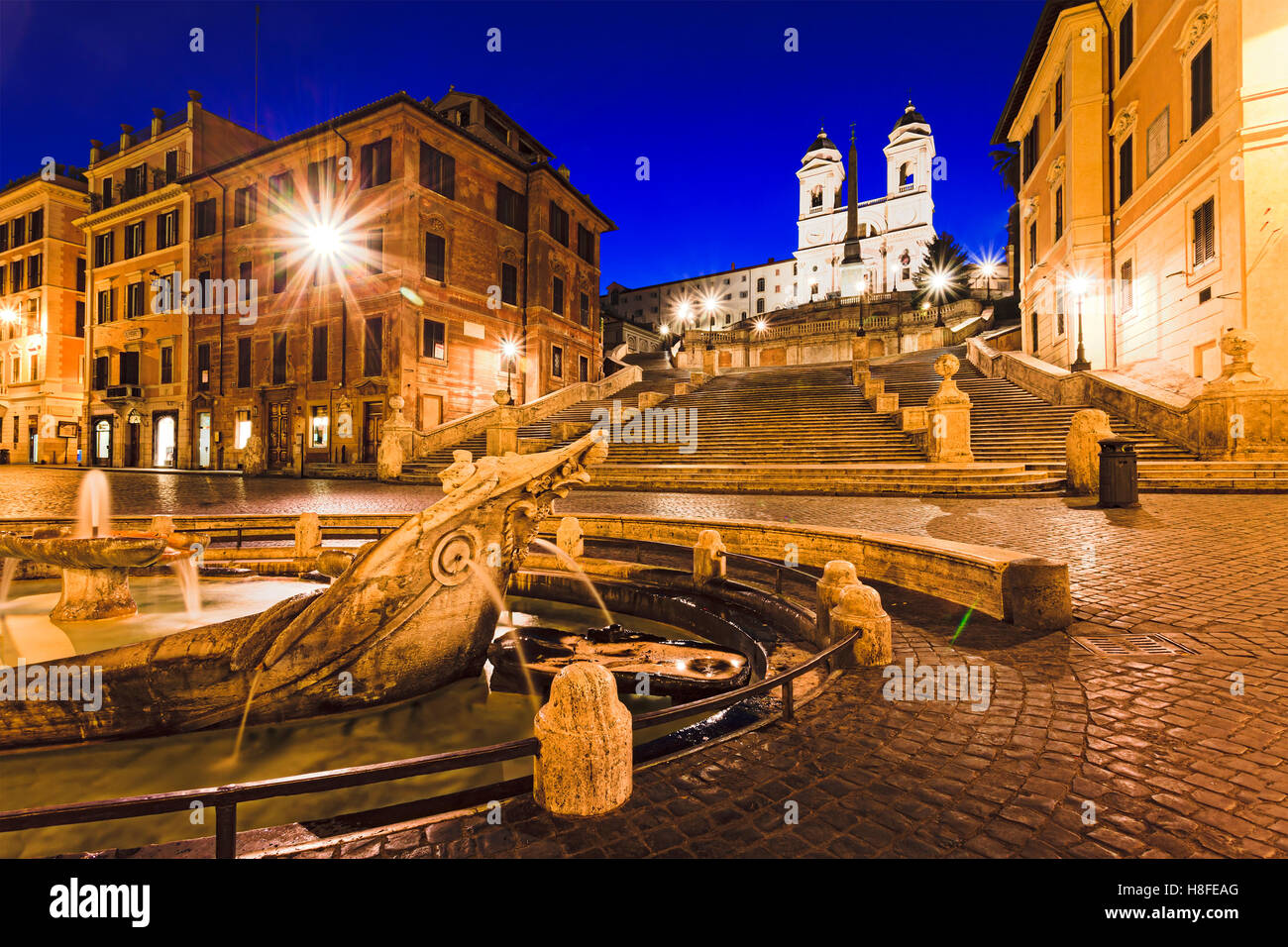 Historic spanish steps , church and boat shaped stone fountain in Rome, Italy, at sunrise. - Stock Image