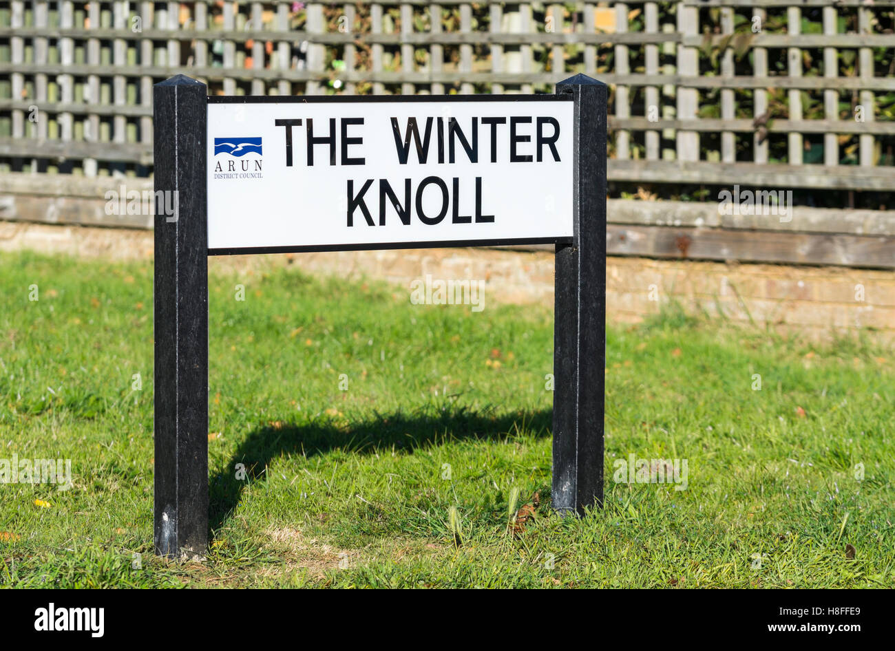 Street name sign on posts in the ground in the UK. - Stock Image