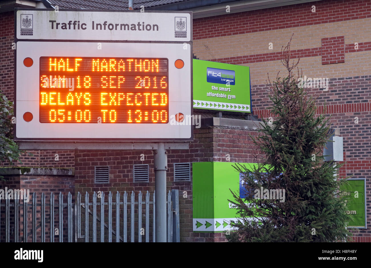 Traffic Information display in Latchford, Warrington. Half Marathon in town - Stock Image