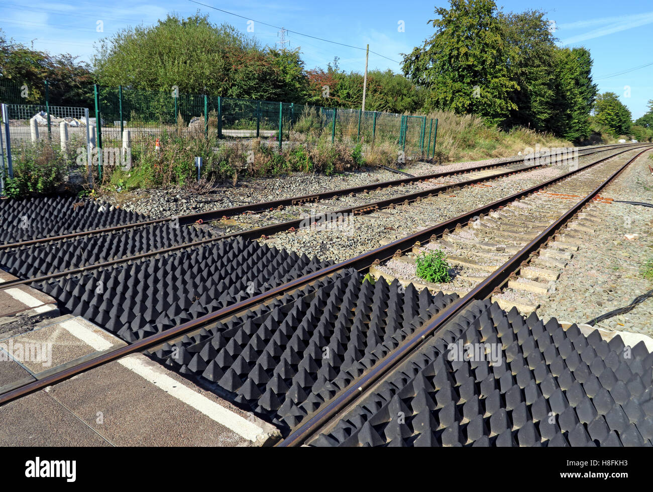 Level crossing at Penketh, Warrington, Cheshire with barriers - Stock Image