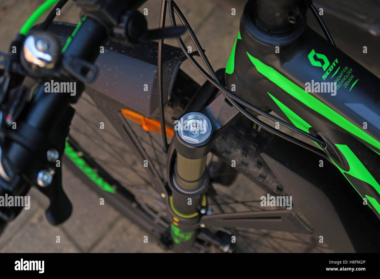 MTB shock pump being used on a Scott Scale 950 Cycle - shock cover cap removed - Stock Image