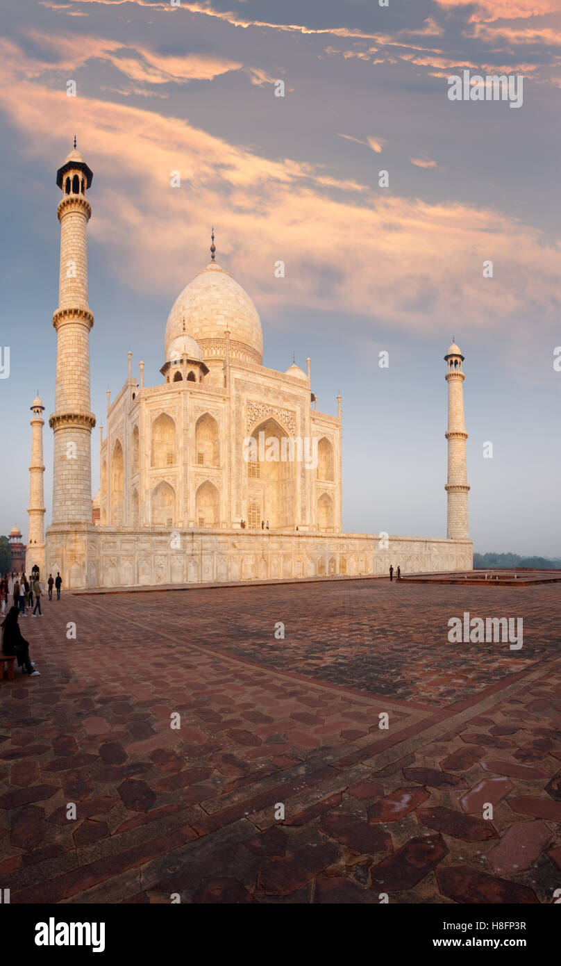 The Taj Mahal seen from the Jawab side on red sandstone platform colorfully reflects bright sunrise colors underneath Stock Photo