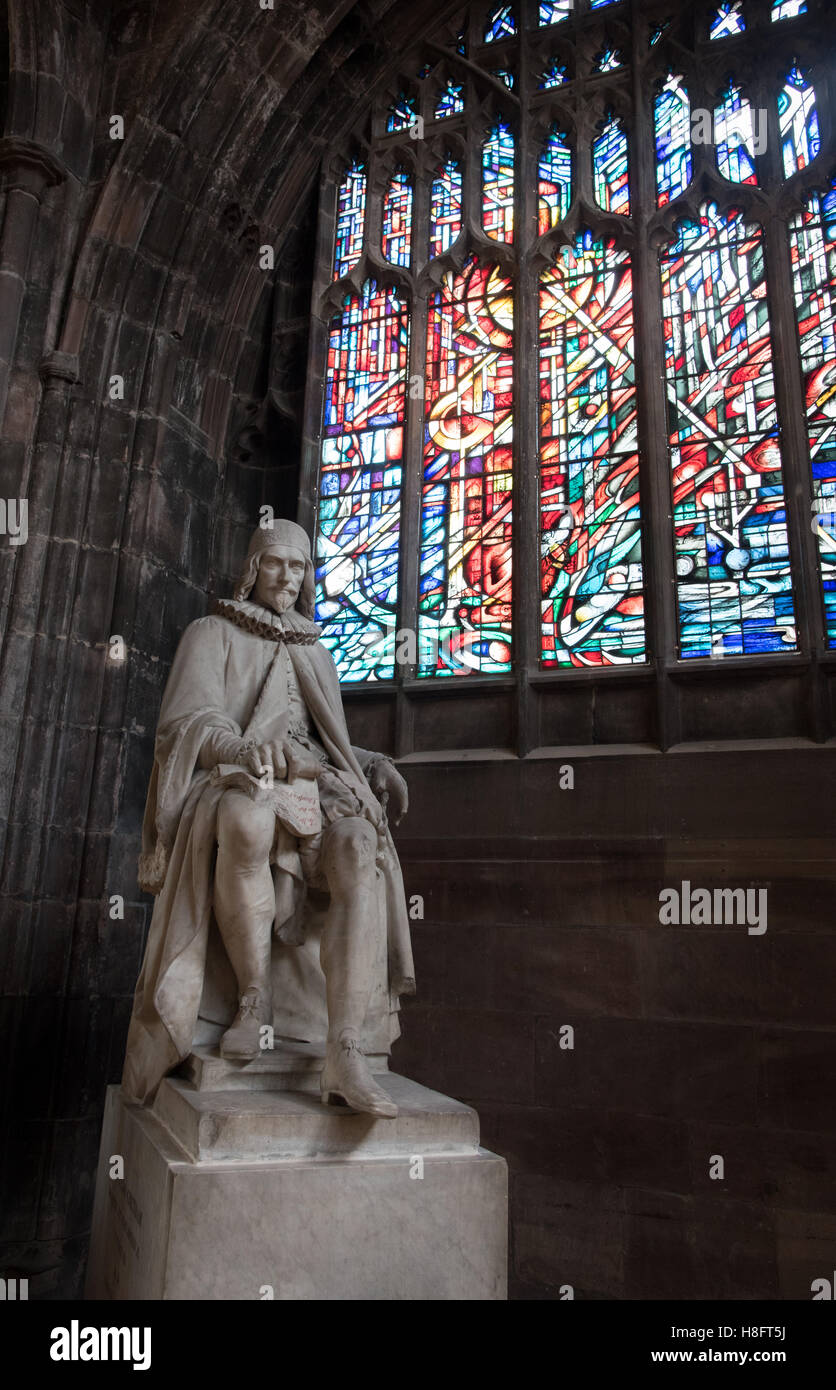 Statue of Humphrey Chetham and colorful stained glass window inside the famous  Manchester Cathedral - Stock Image
