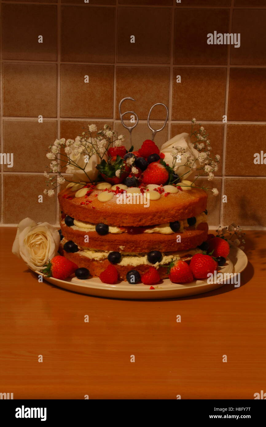 Hand Made Birthday Cake With Three Layers Of Sponge And Decorated Cream Icing Fruits The Occasional Flower