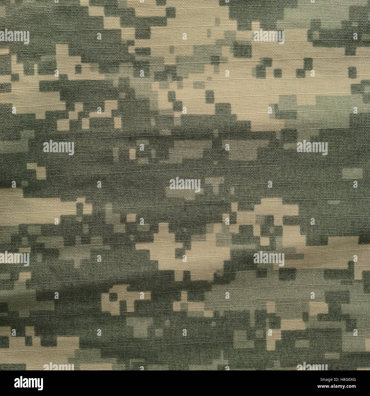 Universal camouflage pattern, army combat uniform digital camo, USA military ACU macro closeup, detailed large rip - Stock Image