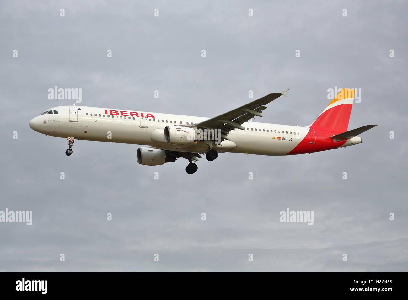 Iberia Airbus A321-212 EC-ILO landing at Heathrow Airport, London - Stock Image