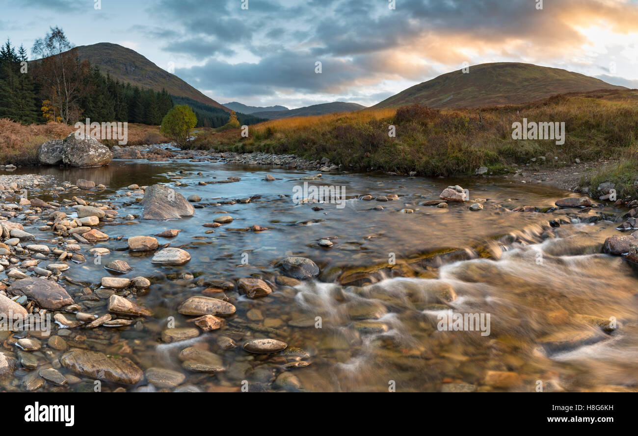 Allt Bail a Mhuilinn flows down the valley from Ben Lawers, Perthshire, Scotland. - Stock Image