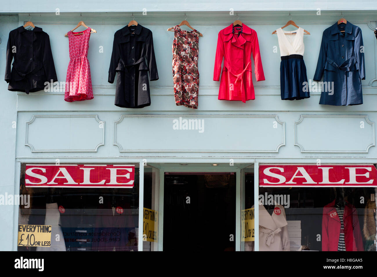 Dresses and waterproof coats on sale in Nothing Hill - Stock Image
