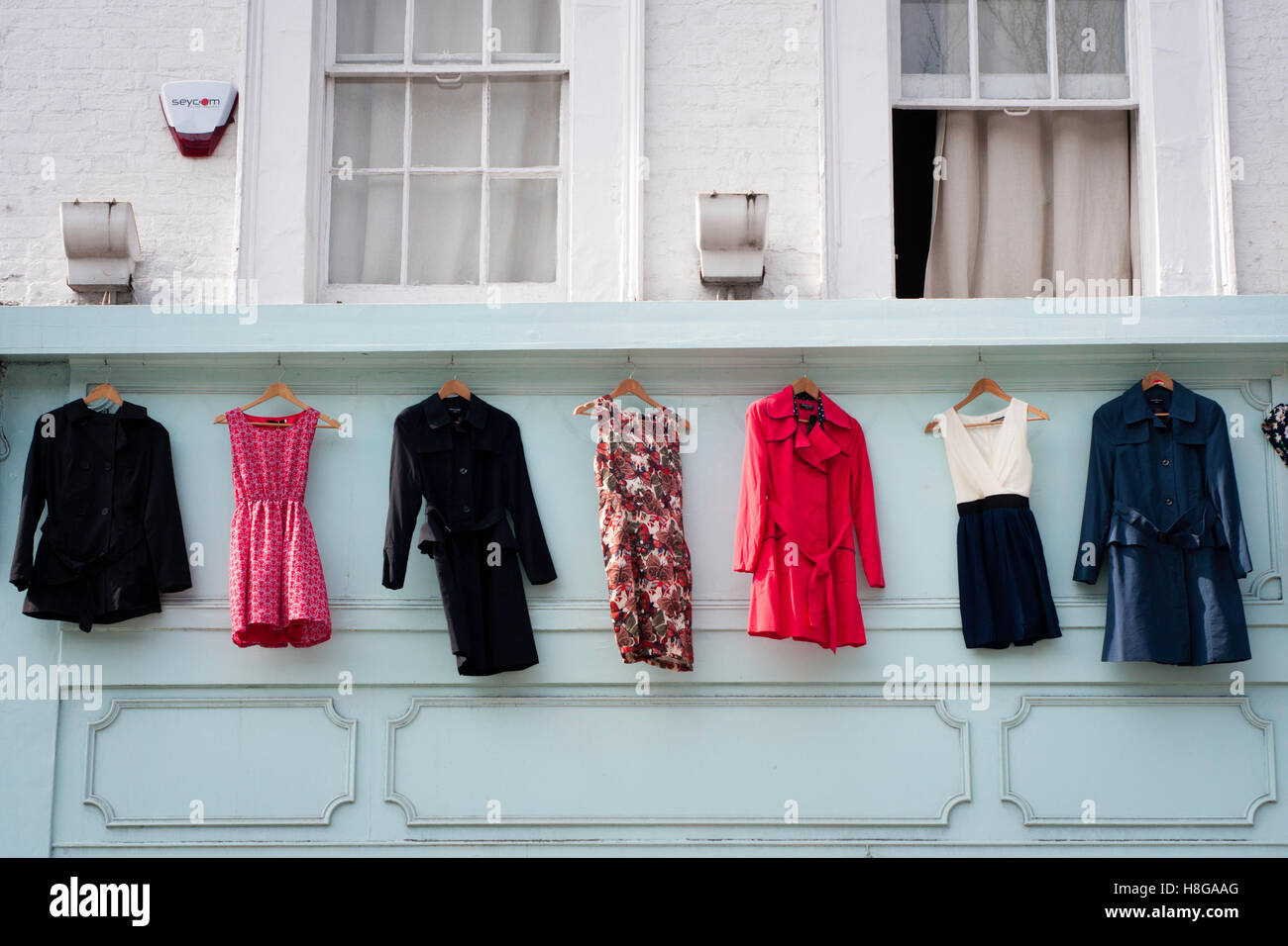 Dresses on display in Nothing Hill (London) - Stock Image