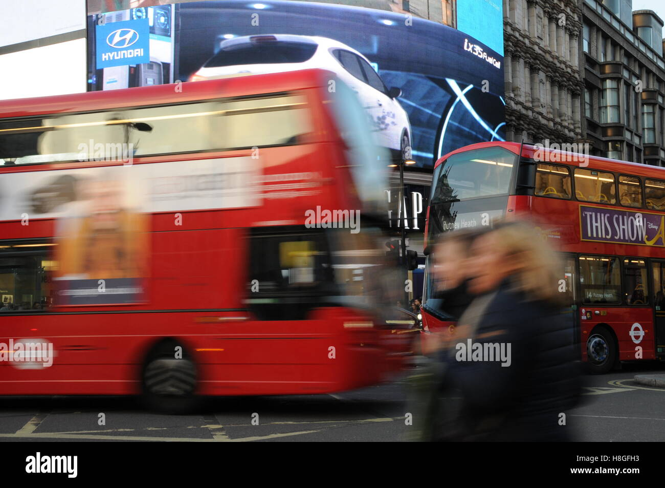 Red London bus in Piccadilly Circus. - Stock Image