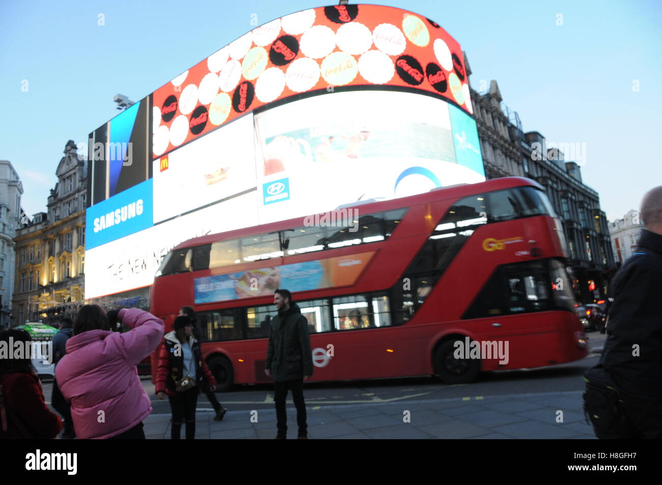 Double-decker bus in London's Piccadilly Circus. - Stock Image