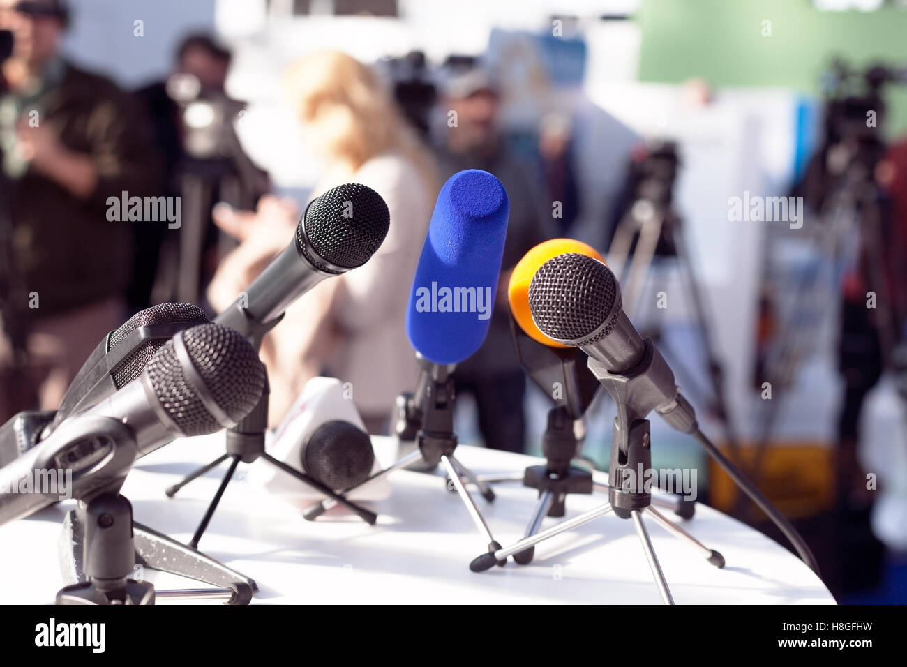 Microphones at press conference - Stock Image