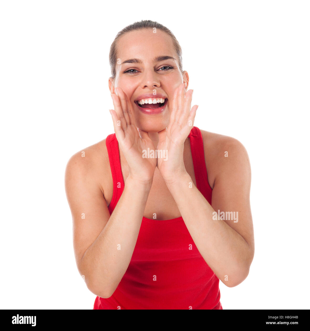Young woman saying something with opened hands around her mouth, isolated on white - Stock Image