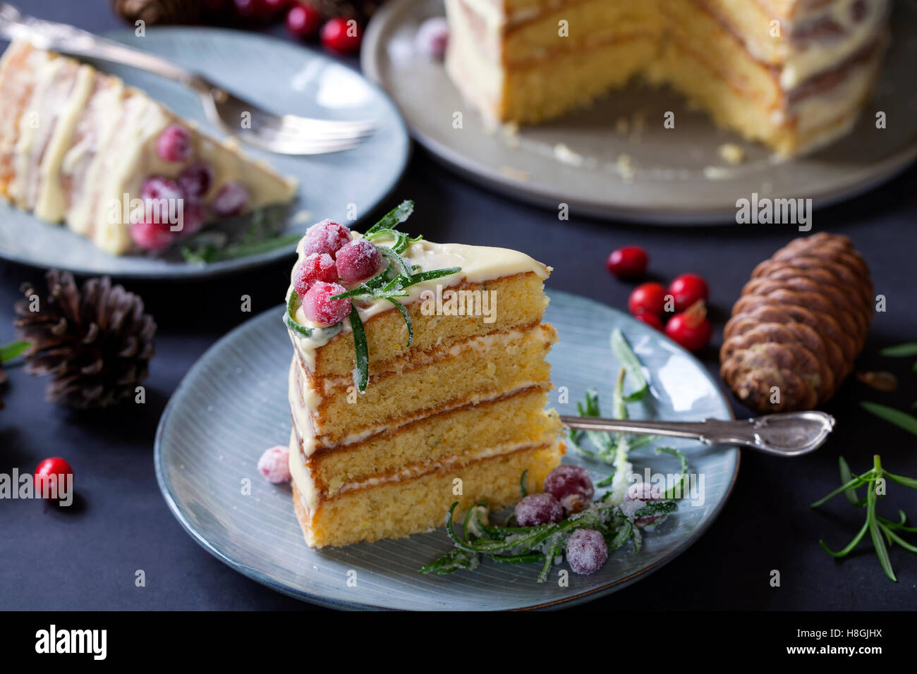 layered Christmas cake with sugared cranberries and rosemary Stock Photo