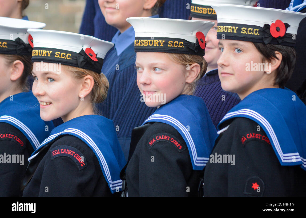 Boys and girls Sea Cadets in uniform smiling in a lighter