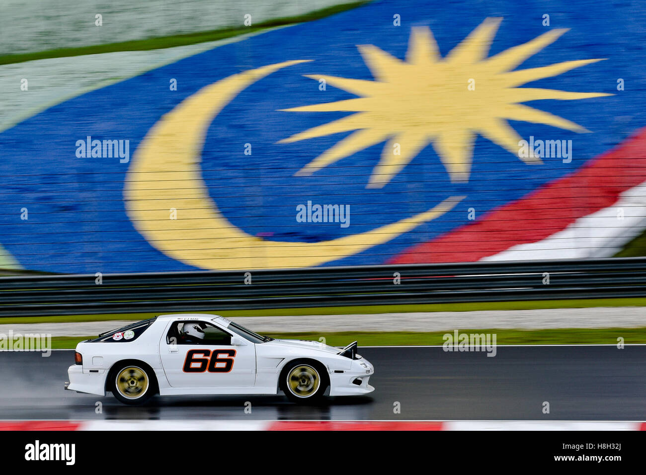 Mac Chung Jin Driving The (66) Mazda RX7 On Track During The Asia Classic
