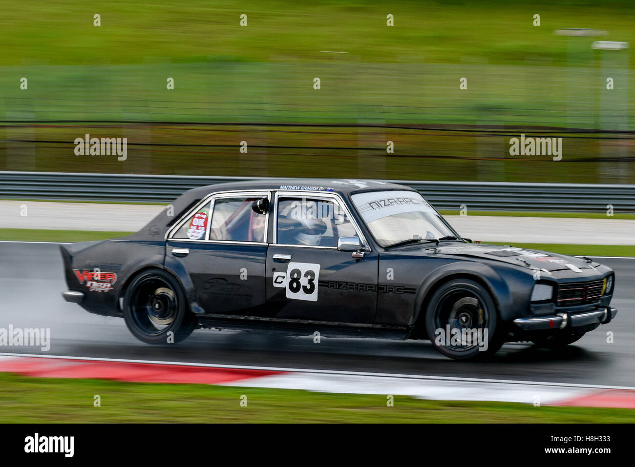 Matthew Graham Driving The 83 Peugeot 504 On Track During The Asia