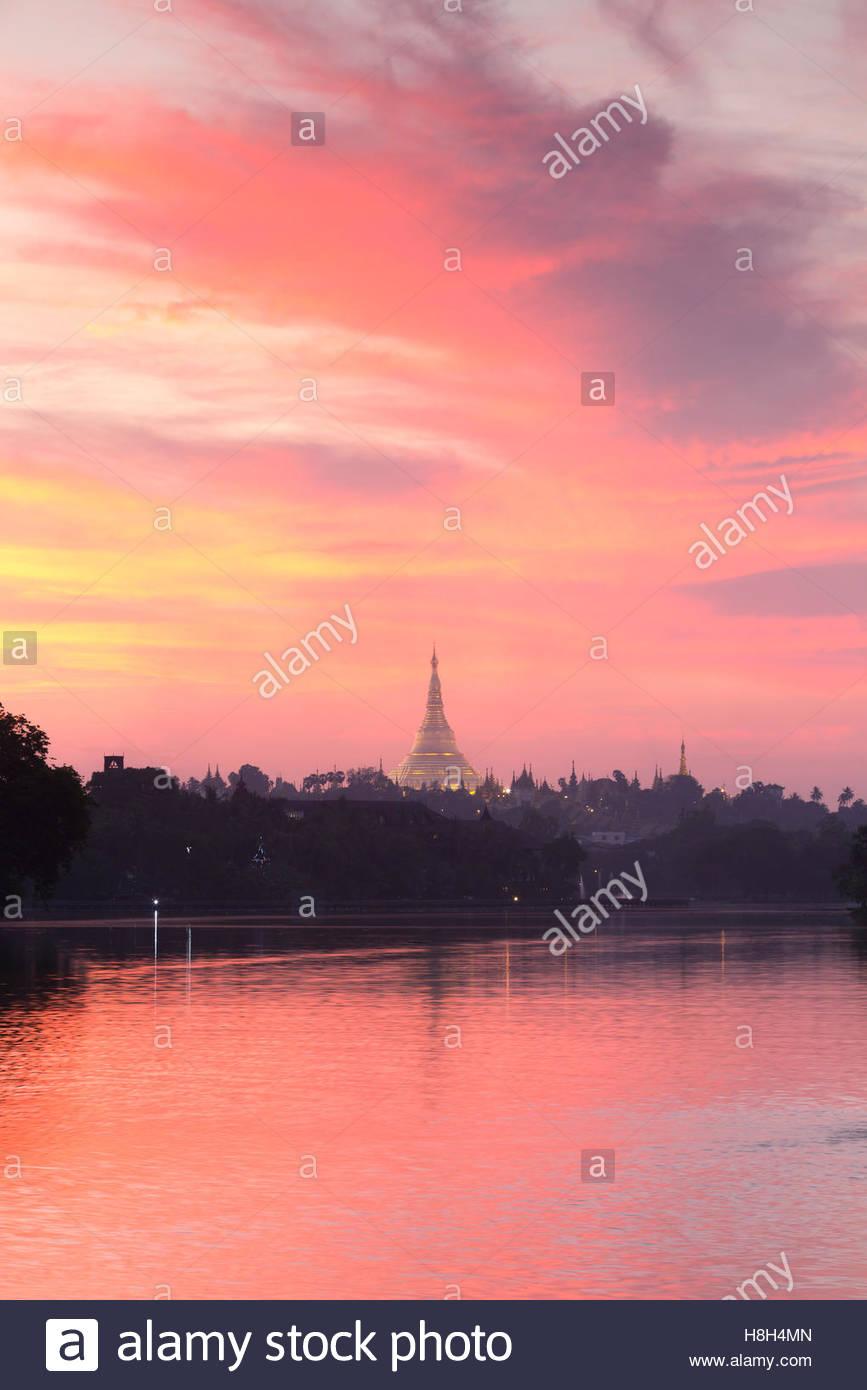 Shwedagon pagoda at sunset, as seen from Kandawgyi lake, Yangon, Myanmar Stock Photo