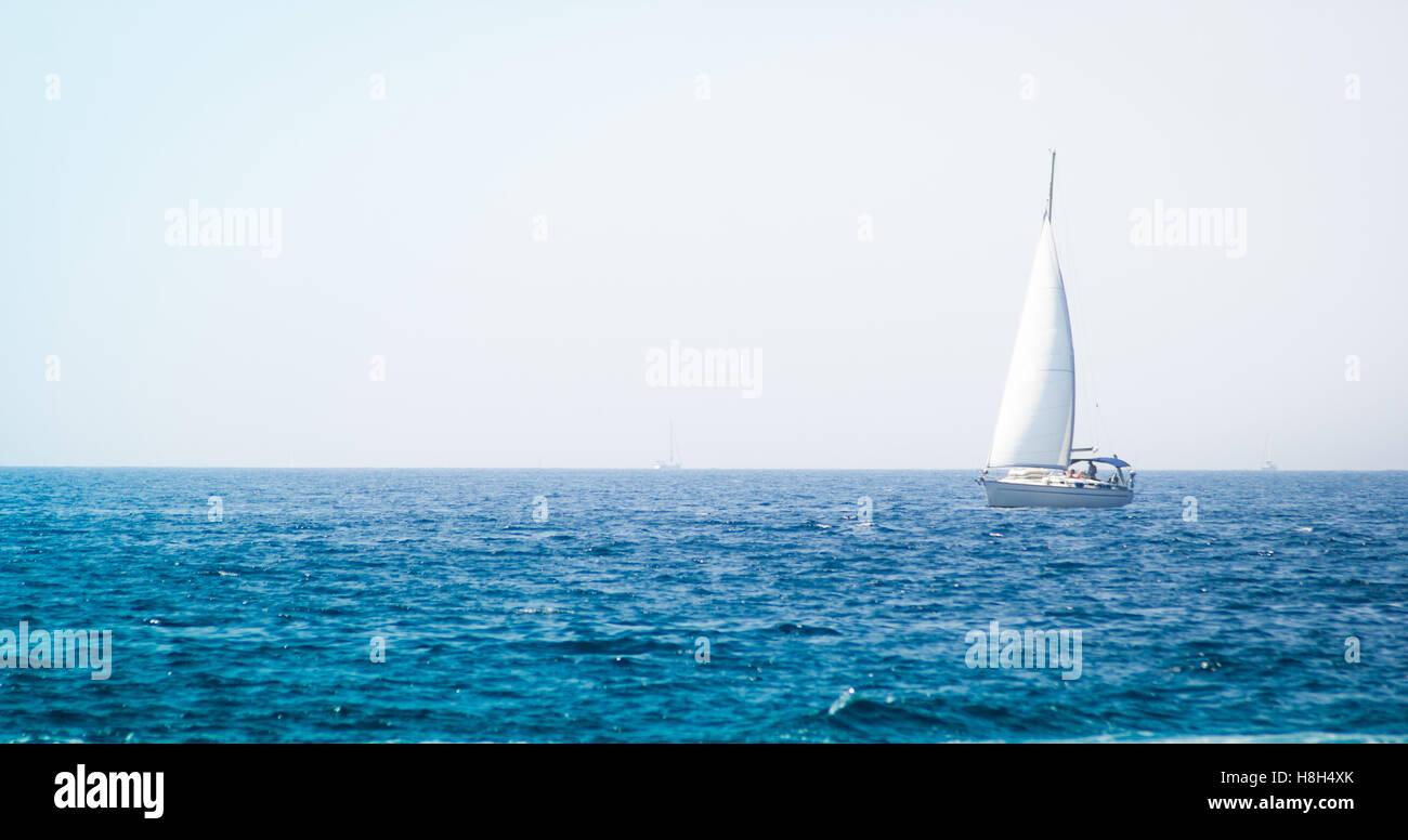Sailboat yacht on blue sea - Stock Image