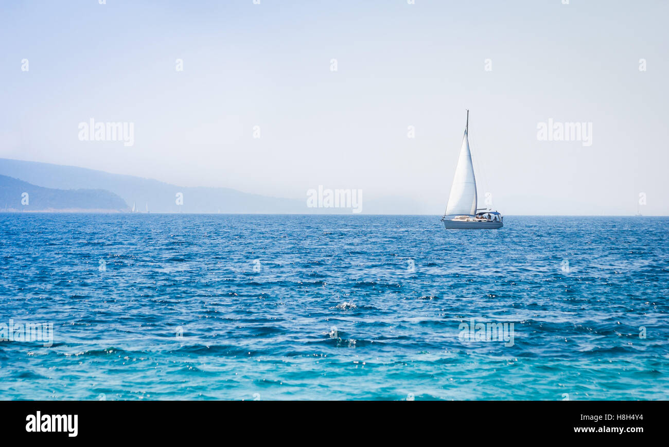Sailboat yacht on the sea - Stock Image