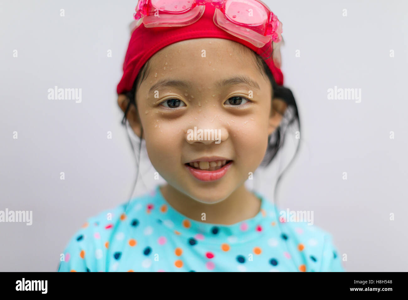 Portrait of Asian child in swimming suit. - Stock Image