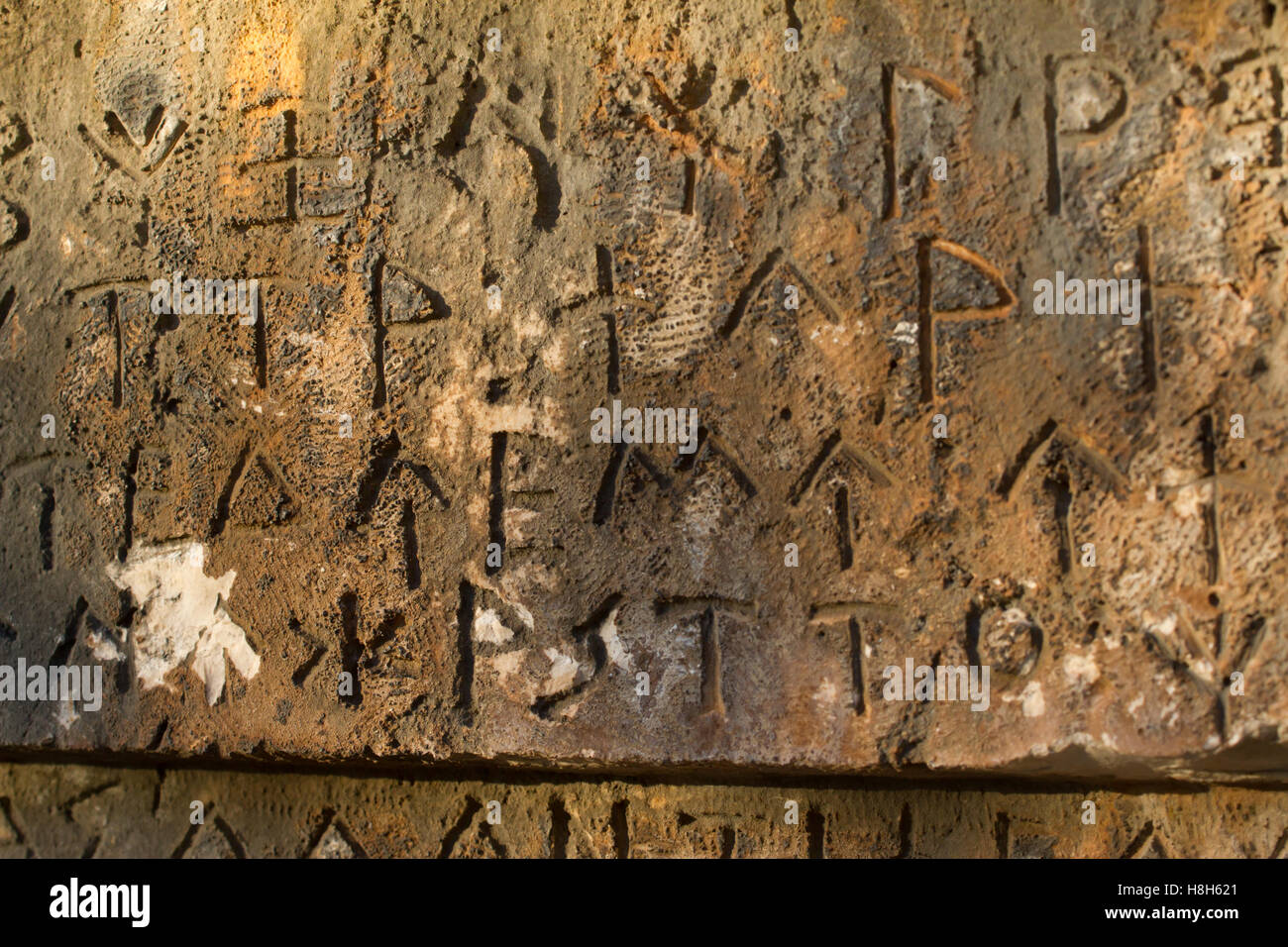 Inscription on ancient tomb in the Greek language. Characters, symbols. Hieroglyphs - Stock Image