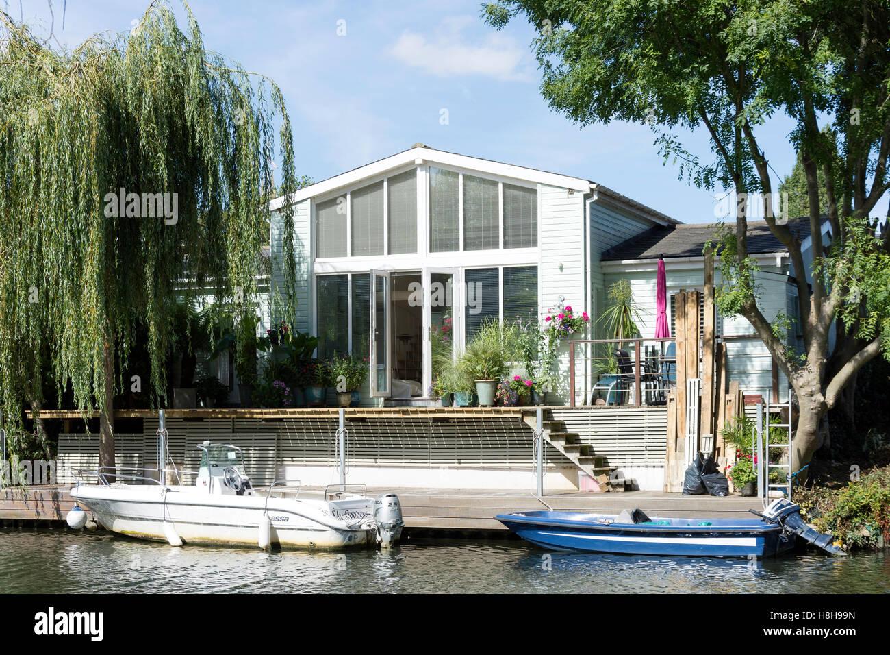 Riverside house on Tagg's Island, River Thames, Hurst Park, West Molesey, Surrey, England, United Kingdom Stock Photo