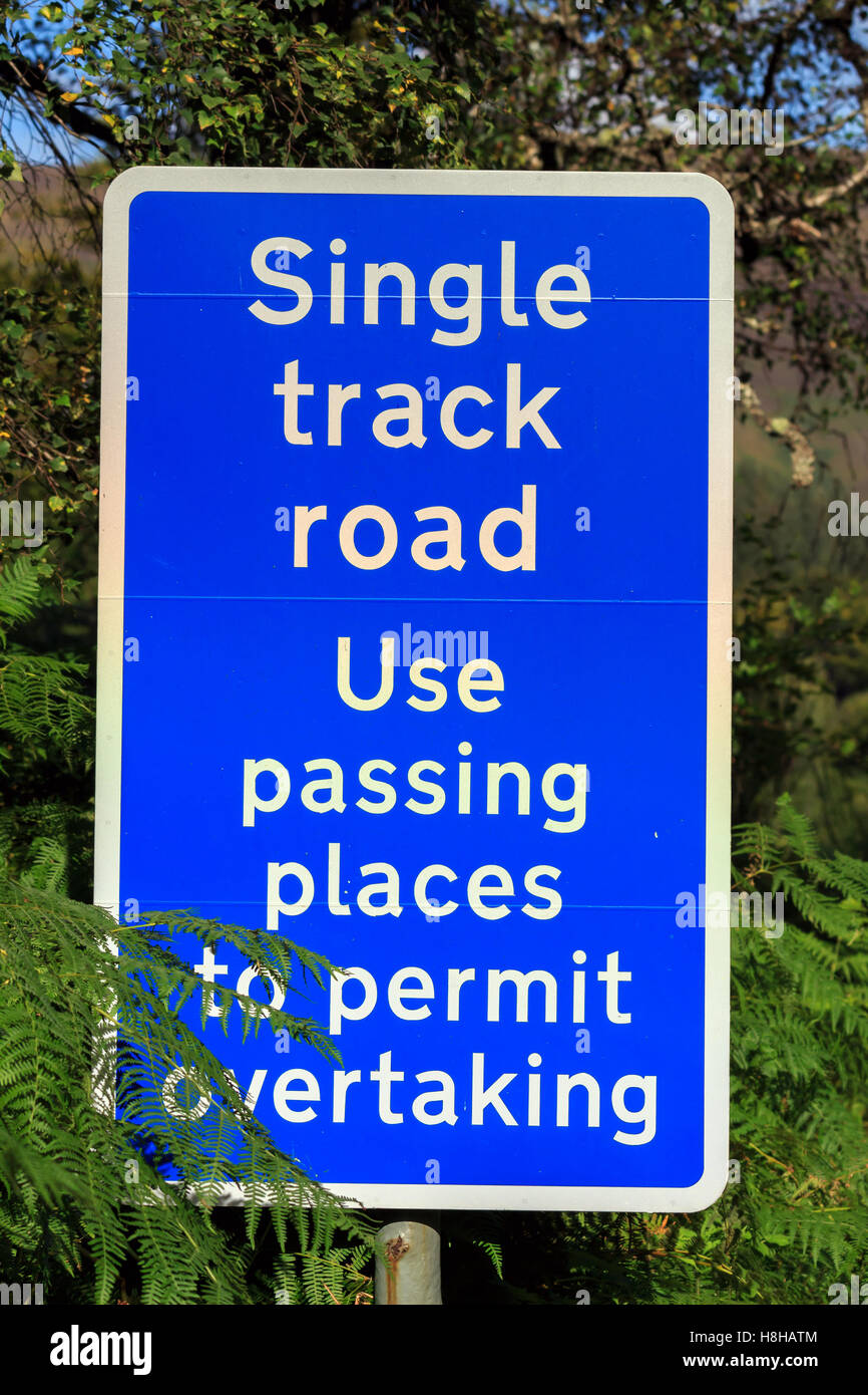 Road traffic sign advising Single Track Road, use passing places to permit overtaking - Stock Image