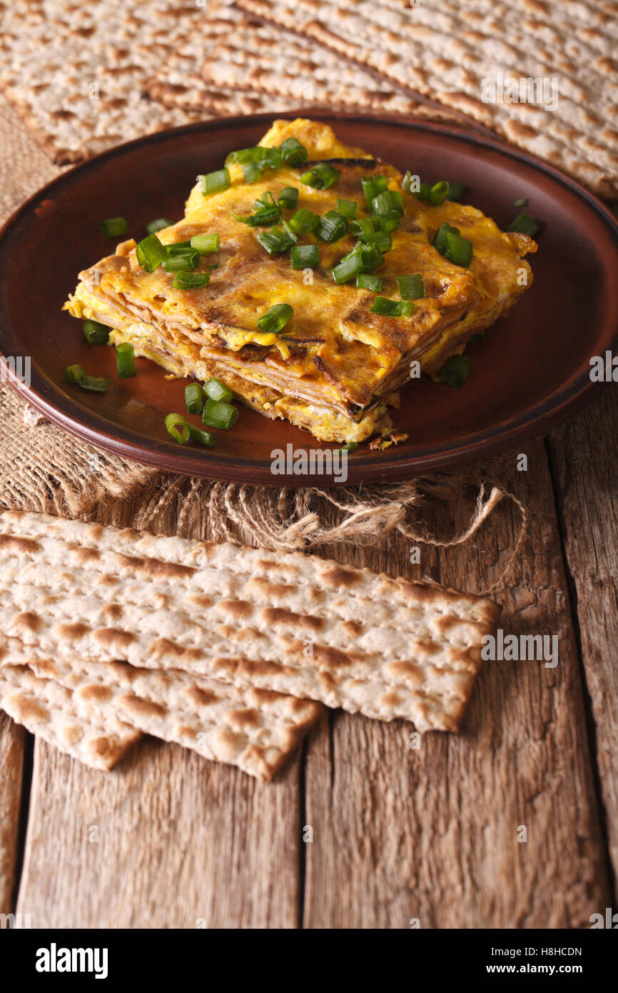 Jewish omelette: matzah brei with green onions close-up on a plate. Vertical - Stock Image