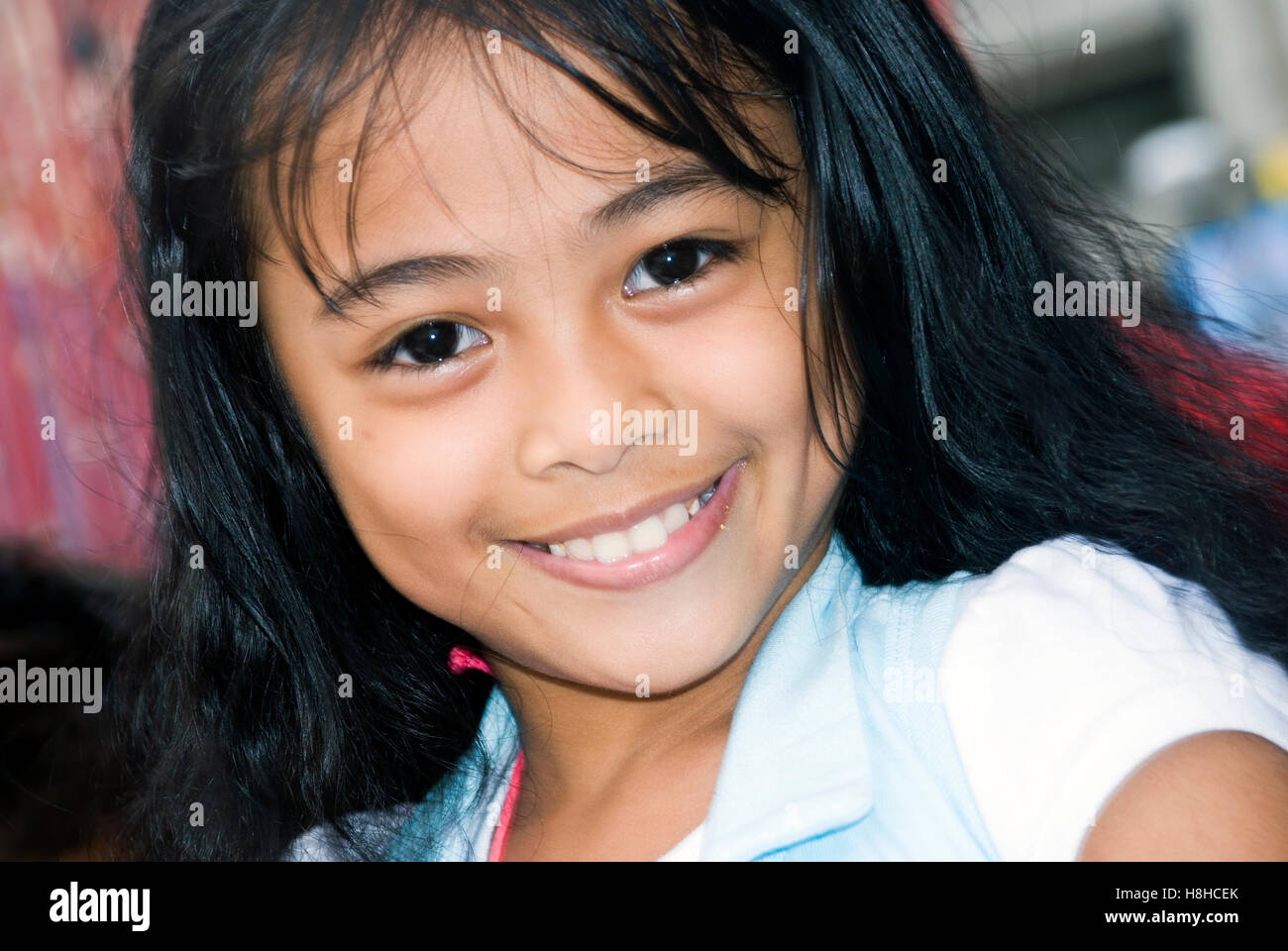 Mlada deklica v Manili, Filipini Stock Photo 125772827-9447