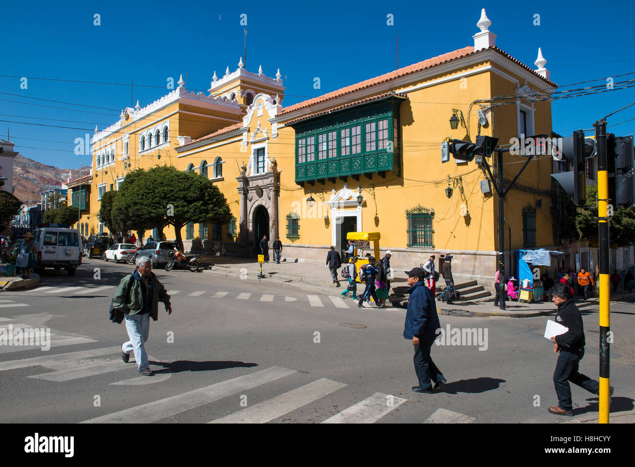 Potosi, Bolivia - November 29, 2013: People crossing a crosswalk the city of Potosi in Bolivia. - Stock Image
