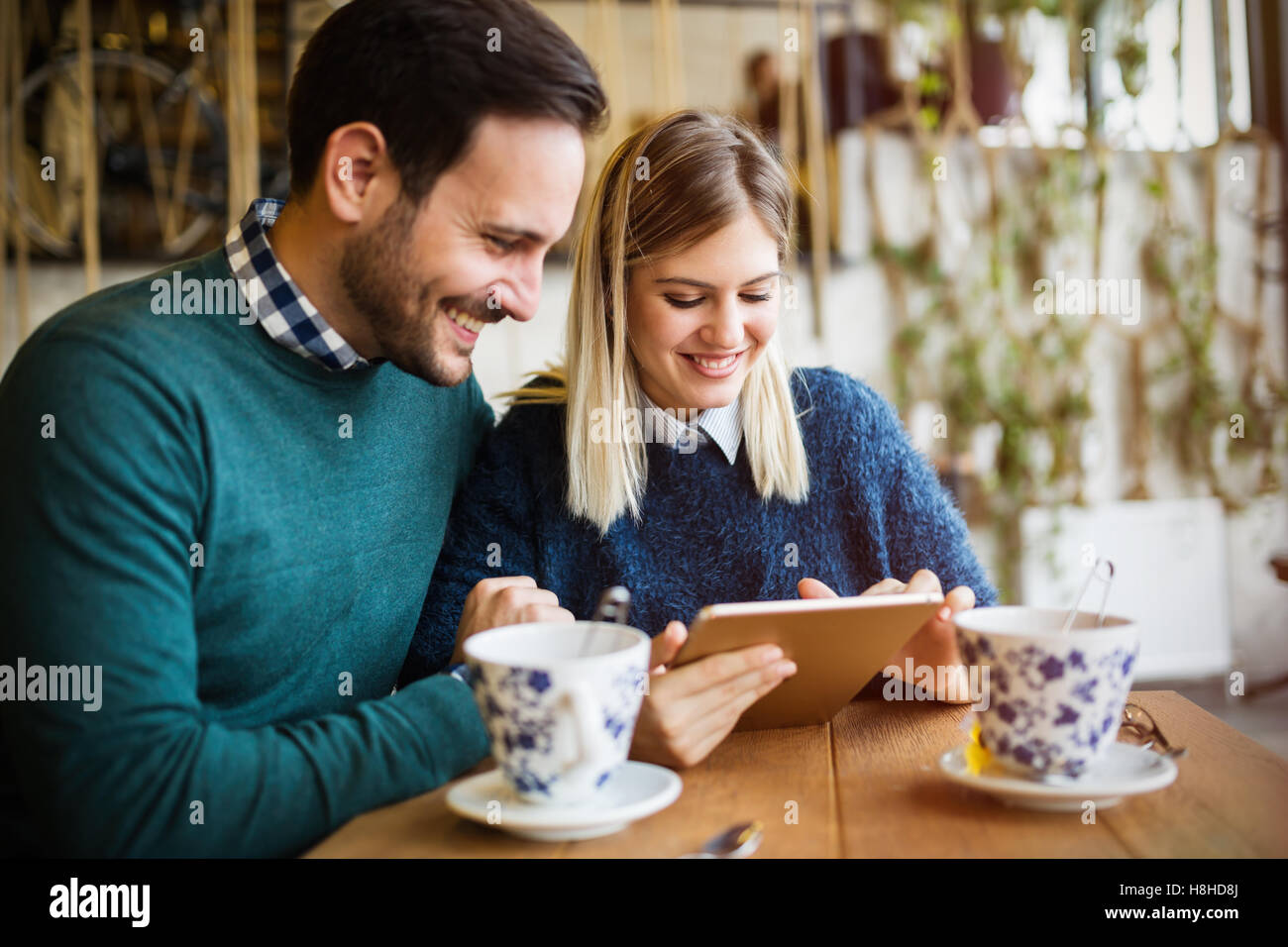 Couple in love  dating in restaurant - Stock Image