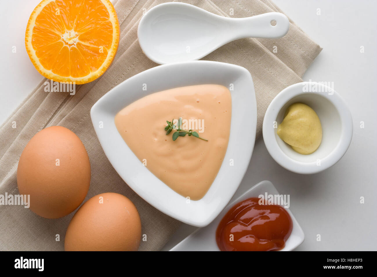 Cocktail sauce in a white bowl with orange, eggs, ketchup and Stock ...