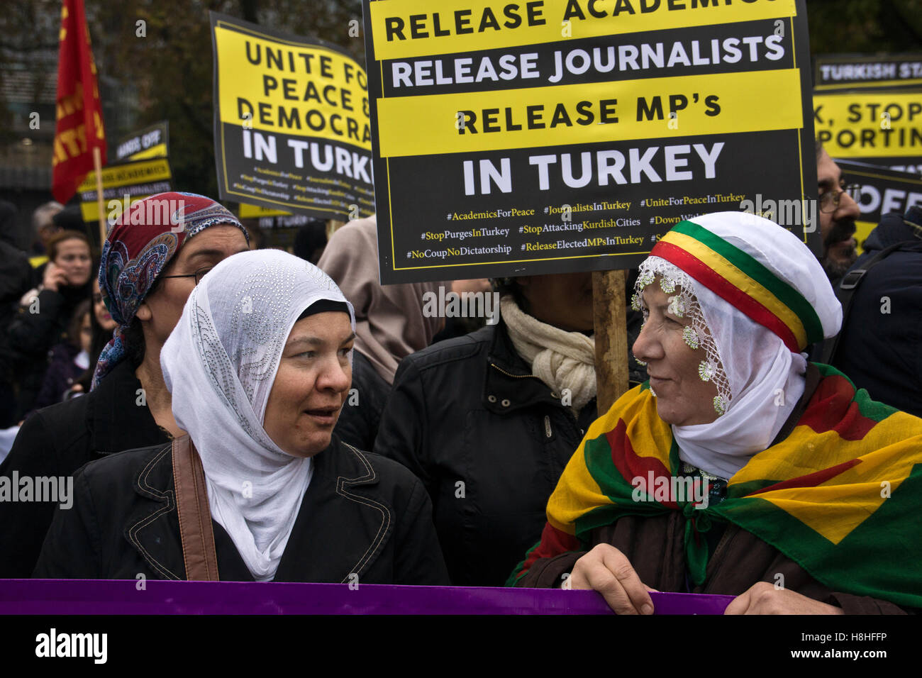 Two Kurdish female protesters holding a placard against censorship and closure of kurdish political party HDP in Stock Photo