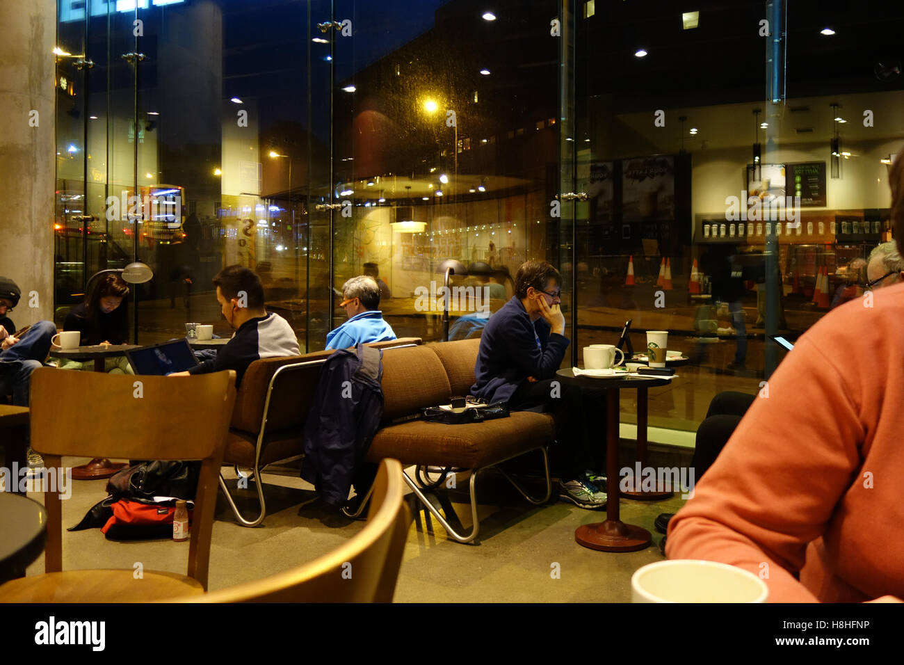Customers in cafe - Stock Image