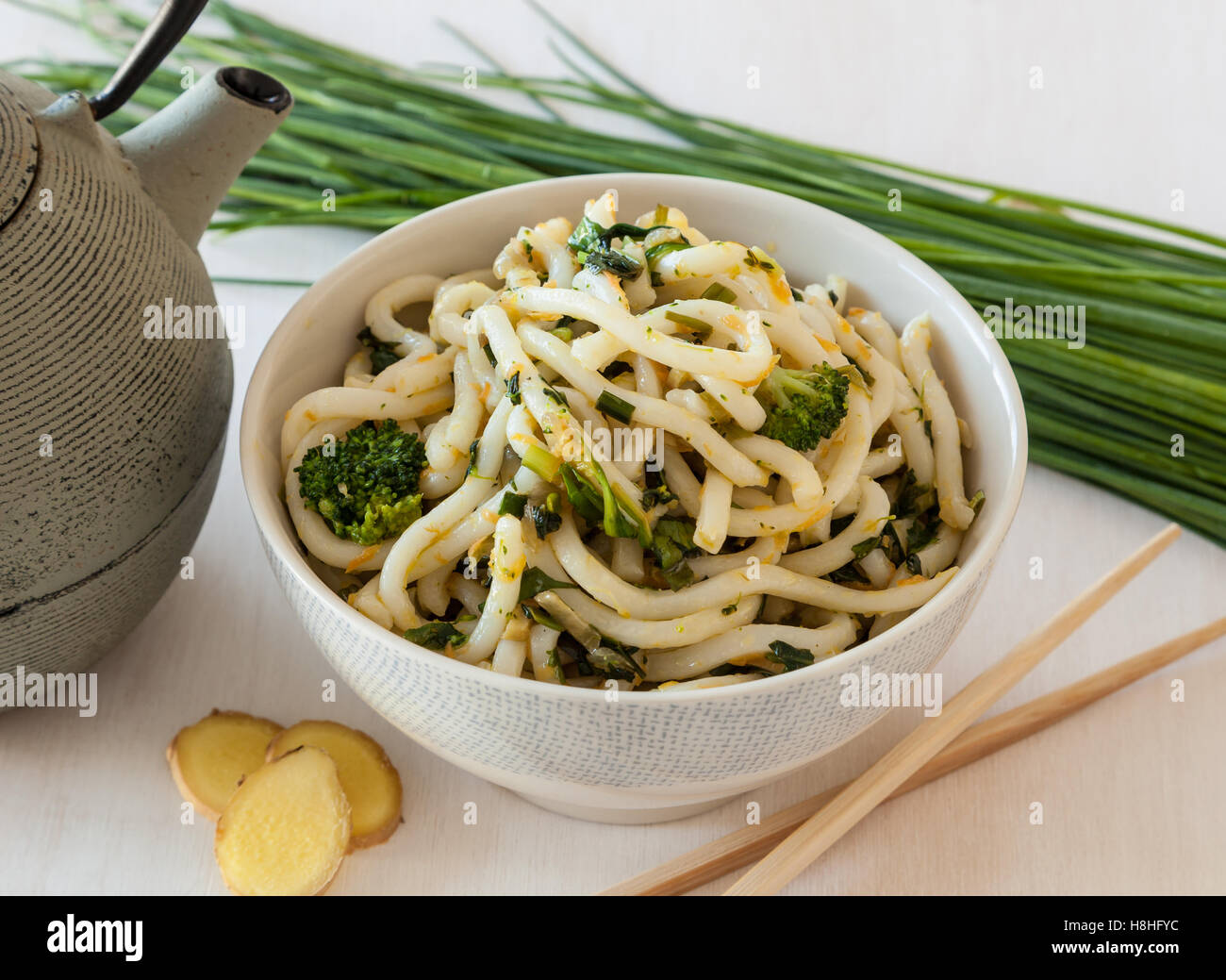 Japanese food. Udon noodles with broccoli and vegetables - Stock Image