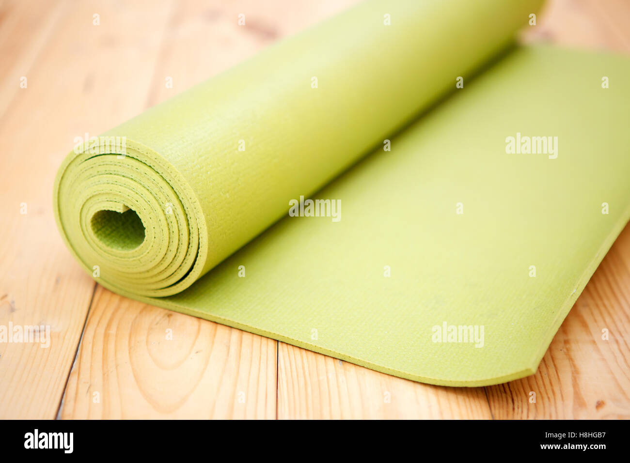 Twisted green mat for exercise - Stock Image