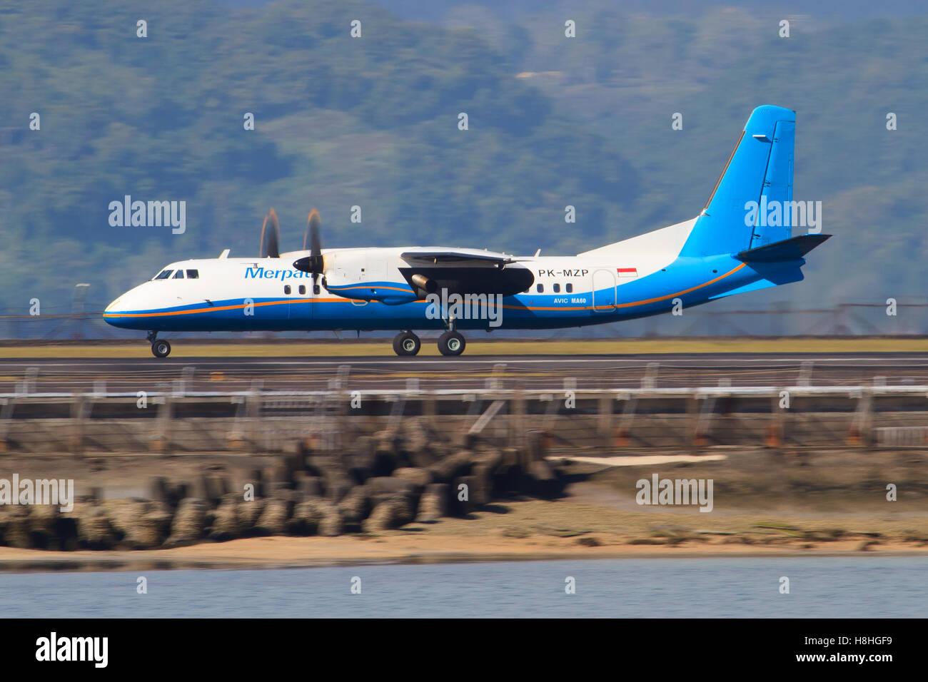 Bali/Indonesia Februar 19, 2013: Xiâ??an MA60 from Xiâ??an MA60 takeoff at Bali Airport. - Stock Image
